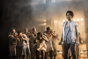 Tyrone Huntley as Judas and Ensemble. Photo Johan Persson.